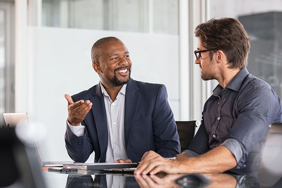 Client Center - Two Businessmen Talking in Modern Office